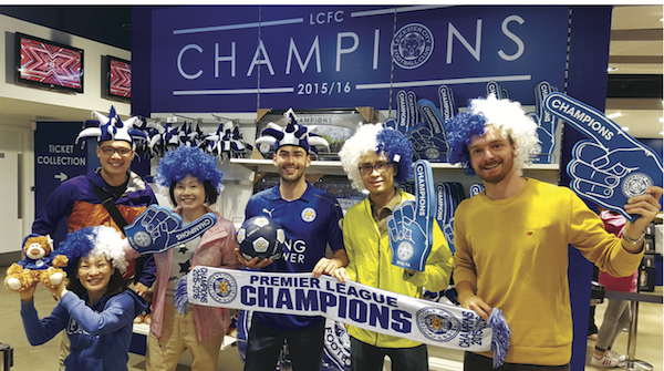 Posing at the LCFC Store, Grant Cotton (centred) showing a tourist from Slovakia (far right) the Sights of Leicester.
