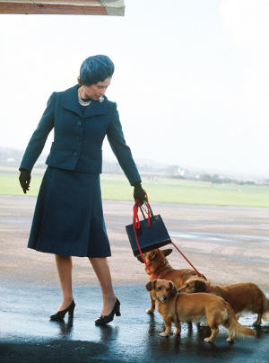 The Queen arrives at Aberdeen Airport with her dogs to start her holidays at Balmoral, June 1974 CREDIT: Anwar Hussein