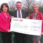 A cheque for £19,166 being presented to MND